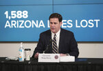 Arizona Gov. Doug Ducey updates reporters on COVID-19 in the state, during a news conference in Phoenix on Monday, June 29, 2020. Ducey ordered bars, nightclubs and water parks to close again for at least a month starting Monday night — a dramatic about-face as coronavirus cases surge in the Sunbelt. (Michael Chow/The Arizona Republic via AP, Pool)