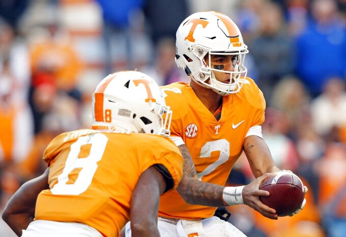 FILE - In this Nov. 10, 2018, file photo, Tennessee quarterback Jarrett Guarantano (2) hands the ball off to running back Ty Chandler (8) in an NCAA college football game against Kentucky in Knoxville, Tenn. Tennessee is hoping to improve after going 5-7 in 2018 while posting a second straight last-place finish in the Southeastern Conference Eastern Division. (AP Photo/Wade Payne, File)
