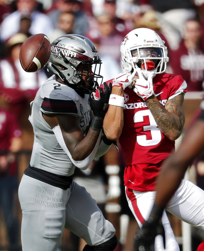 Mississippi State cornerback Jamal Peters (2) breaks up a pass intended for Arkansas wide receiver Deon Stewart (3) during the first half of an NCAA college football game in Starkville, Miss., Saturday, Nov. 17, 2018. (AP Photo/Rogelio V. Solis)
