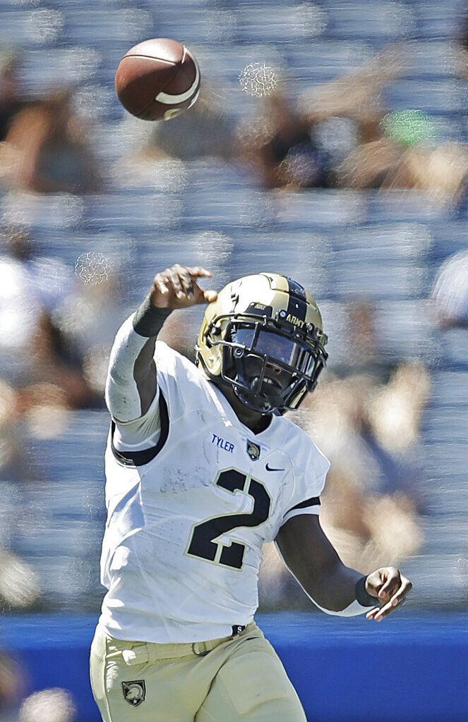 Army quarterback Tyhier Tyler passes against Georgia State in the first half of an NCAA football game Saturday, Sept. 4, 2021, in Atlanta. (AP Photo/Ben Margot)
