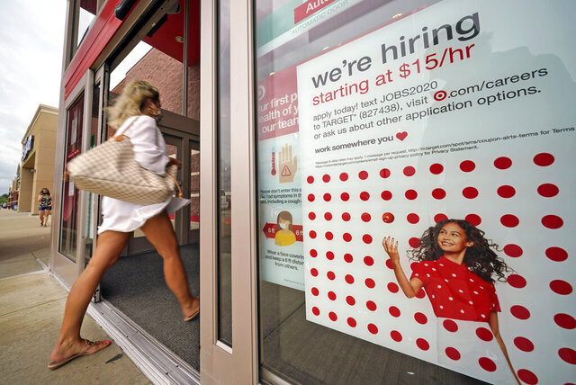 FILE - In this Sept. 2, 2020, file photo, a help wanted sign hangs on the door of a Target store in Uniontown, Pa. Hundreds of thousands of Americans likely applied for unemployment benefits last week, a high level of job insecurity that reflects economic damage from the coronavirus outbreak. Economists expect that 850,000 people sought jobless aid, down from 884,000 the week before, according to a survey by the data firm FactSet. (AP Photo/Gene J. Puskar, File)