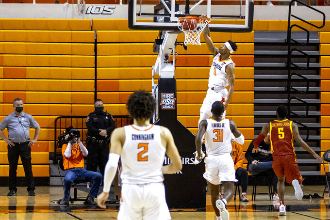 Oklahoma State guard Avery Anderson III (0) slam dunks the ball during the first half of the NCAA college basketball game against IOwa State in Stillwater, Okla., Tuesday, Feb. 16, 2021. (AP Photo/Mitch Alcala)