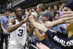 Butler's Kamar Baldwin (3) celebrates with fans after Butler defeat Marquette in overtime of an NCAA college basketball game against Marquette, Friday, Jan. 24, 2020, in Indianapolis. Butler won 89-85. (AP Photo/Darron Cummings)