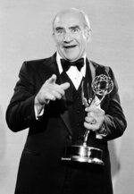 """FILE - In this Sept.17, 1978., file photo, actor Ed Asner poses backstage with his Emmy statuette at the 30th annual Primetime Emmy Awards at the Pasadena Civic Auditorium, in Pasadena, Calif. Asner won his sixth Emmy for Outstanding Lead Actor in a Drama Series for """"Lou Grant."""" Asner, the blustery but lovable Lou Grant in two successful television series, has died. He was 91. Asner's representative confirmed the death in an email Sunday, Aug. 29, 2021, to The Associated Press. (AP Photo, File)"""
