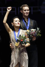 Ice dance competition winners, gold medalists, Madison Chock and Evan Bates, of the United States, pose at the Four Continents Figure Skating Championships on Sunday, Feb. 10, 2019, in Anaheim, Calif. (AP Photo/Chris Carlson)