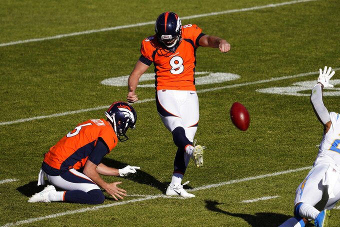Denver Broncos kicker Brandon McManus (8) kicks a field goal as punter Sam Martin (6) holds during the first half of an NFL football game against the Los Angeles Chargers, Sunday, Nov. 1, 2020, in Denver. (AP Photo/Jack Dempsey)