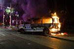 A Police vehicle burns after protesters rallied at Barclays Center over the death of George Floyd, a black man who died Memorial Day while in Minneapolis police custody, Friday, May 29, 2020, in the Brooklyn borough of New York. (AP Photo/Frank Franklin II)