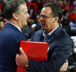 Kentucky head coach John Calipari, left, and Georgia head coach Tom Crean shake hands before an NCAA college basketball game in Athens, Ga., Tuesday, Jan. 7, 2020. (Joshua L. Jones/Athens Banner-Herald via AP)