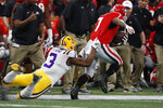 LSU safety JaCoby Stevens (3) hits Georgia running back D'Andre Swift (7) during the first half of the Southeastern Conference championship NCAA college football game, Saturday, Dec. 7, 2019, in Atlanta. (AP Photo/John Bazemore)