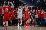 Utah's Riley Battin (21) celebrates after making a 3-point shot against Kentucky during the second half of an NCAA college basketball game Wednesday, Dec. 18, 2019, in Las Vegas. (AP Photo/John Locher)