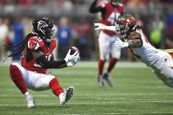 Atlanta Falcons outside linebacker De'Vondre Campbell (59) intercepts the ball against the Tampa Bay Buccaneers during the first half of an NFL football game, Sunday, Nov. 24, 2019, in Atlanta. (AP Photo/Danny Karnik)