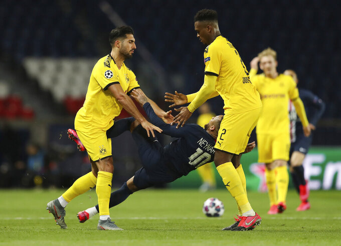 Paris Saint Germain's Neymar, center, is pushed by Borussia Dortmund's Emre Can, left, during the Champions League round of 16 second leg soccer match between PSG and Borussia Dortmund, Wednesday March 11, 2020 in Paris. The match is being played in an empty stadium because of the coronavirus outbreak. (UEFA via AP)