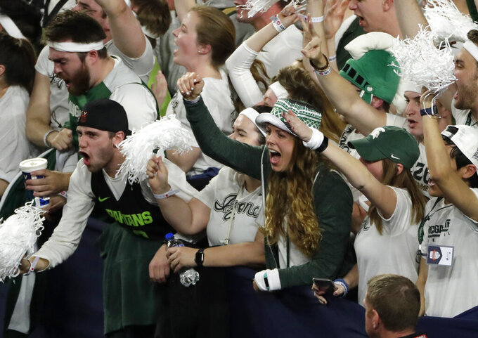 Michigan State fans cheer during the first half against Texas Tech in the semifinals of the Final Four NCAA college basketball tournament, Saturday, April 6, 2019, in Minneapolis. (AP Photo/Matt York)