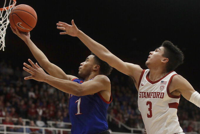 Kansas guard Devon Dotson (1) shoots against Stanford guard Tyrell Terry (3) during the second half of an NCAA college basketball game in Stanford, Calif., Sunday, Dec. 29, 2019. (AP Photo/Jeff Chiu)