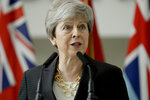 Britain's outgoing Prime Minister Theresa May delivers a speech at headquarters of Joint Forces Command in Northwood, north west London, Monday, July 8, 2019. The base houses operations for British and NATO forces. (AP Photo/Matt Dunham, Pool)