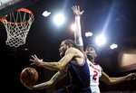 Saint Mary's guard Logan Johnson (1) goes to the basket while Wisconsin forward Aleem Ford (2) defends during the first half of an NCAA college basketball game Tuesday, Nov. 5, 2019, in Sioux Falls, S.D. (Abigail Dollins/Argus Leader via AP)