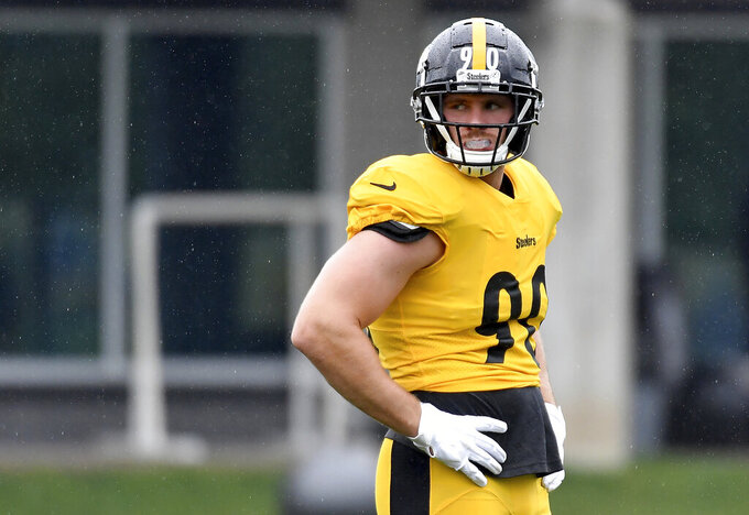 Steelers linebacker T.J. Watt waits for a drill to begin during the NFL football team's practice Wednesday, Sept. 8, 2021, in Pittsburgh. (Matt Freed/Pittsburgh Post-Gazette via AP)