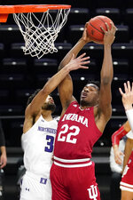 Indiana forward Jordan Geronimo, right, rebounds the ball against Northwestern guard Boo Buie during the first half of an NCAA college basketball game in Evanston, Ill., Wednesday, Feb. 10, 2021. (AP Photo/Nam Y. Huh)