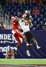 Texas Tech defensive back Reggie Pearson Jr. (22) intercepts a pass under Houston wide receiver KeSean Carter (20) from Houston quarterback Clayton Tune during the first half of an NCAA college football game Saturday, Sept. 4, 2021, in Houston. (AP Photo/Justin Rex)