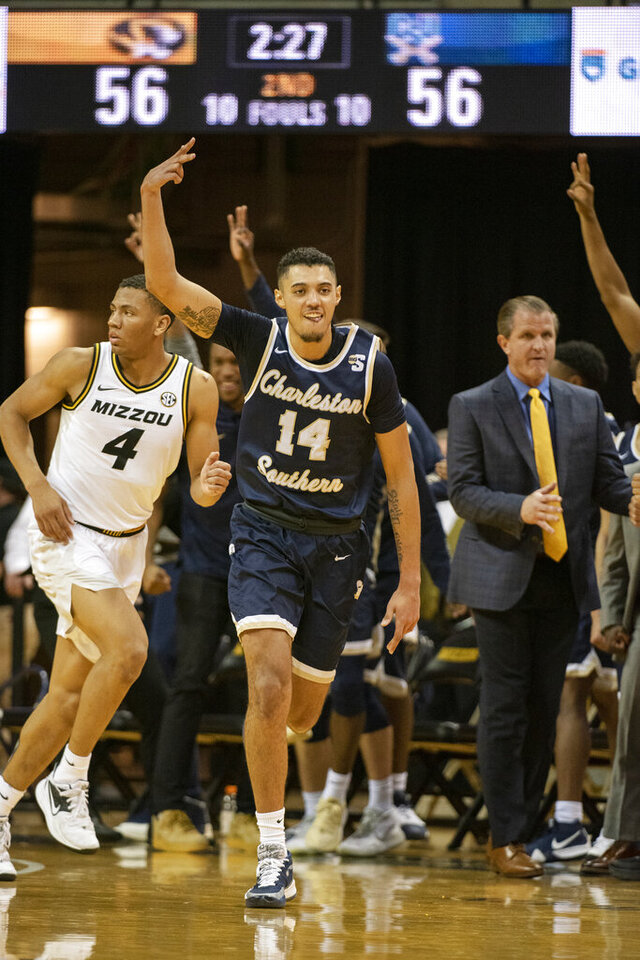 Charleston Southern's Duncan LeXander, center, celebrates a three point basket during the second half of an NCAA college basketball game against Missouri Tuesday, Dec. 3, 2019, in Columbia, Mo. Charleston Southern won the game 68-60. (AP Photo/L.G. Patterson)