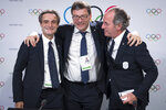 From left, Italy's Lombardy region President Attilio Fontana, Italy's Under Secretary of State Giancarlo Giorgetti and Italy's Veneto Region President Luca Zaia pose after Milan-Cortina won the bid to host the 2026 Winter Olympic Games, during the first day of the 134th Session of the International Olympic Committee (IOC), at the SwissTech Convention Centre, in Lausanne, Switzerland, Monday, June 24, 2019. Italy will host the 2026 Olympics in Milan and Cortina d'Ampezzo, taking the Winter Games to the Alpine country for the second time in 20 years. (Laurent Gillieron/Keystone via AP)