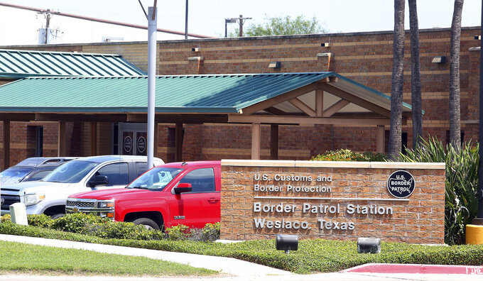 FILE - This Monday, May 20, 2019 file photo shows the Border Patrol Station in Weslaco, Texas. Border Patrol agents are detaining about 65 immigrant children at a station in South Texas in conditions that don't control the spread of the coronavirus, with limited social distancing and a lack of access to soap or hand sanitizer, immigration lawyers said Friday, Nov. 20, 2020.  (Joel Martinez/The Monitor via AP, File)