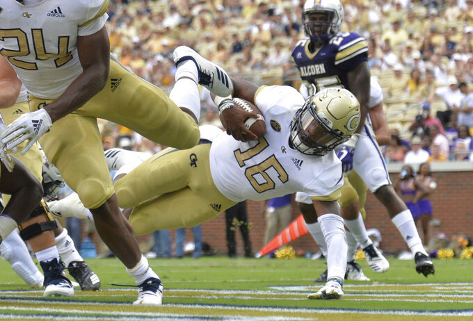 Georgia Tech quarterback TaQuon Marshall (16) dives into the end zone for a touchdown in the first half of an NCAA college football game against Alcorn State  Saturday, Sept. 1, 2018, in Atlanta. (Hyosub Shin/Atlanta Journal-Constitution via AP)