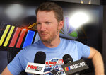 FILE - In this Friday, July 6, 2018 file photo, Dale Earnhardt Jr. goes through an interview during NASCAR auto racing pre-race activities at Daytona International Speedway in Daytona Beach, Fla. NASCAR television analyst and former driver Dale Earnhardt Jr. was taken to a hospital after his plane crashed in east Tennessee. (AP Photo/Mark Long, File)