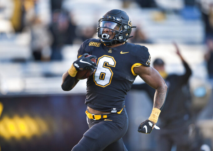 Appalachian State running back Camerun Peoples is untouched on his 63-yard touchdown run in the first half of an NCAA college football game Saturday, Nov. 28, 2020, in Boone, N.C. (Walt Unks/The Winston-Salem Journal via AP)