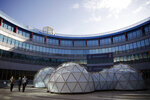 A pollution pod by British artist Michael Pinsky is displayed at the COP25 climate talks summit in Madrid, Spain, Tuesday, Dec. 3, 2019. The chair of a two-week climate summit attended by nearly 200 countries warned at its opening Monday that those refusing to adjust to the planet's rising temperatures
