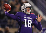 Northwestern's Clayton Thorson makes a pass against Notre Dame during the first half of an NCAA college football game Saturday, Nov. 3, 2018, in Evanston, Ill. (AP Photo/Jim Young)