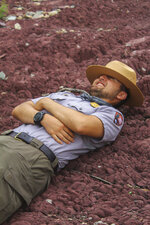 Park Ranger Freddy Fernandez-Ramirez takes his breaks by resting on the ground at Saguaro National Park, Ariz. The 30-year-old was recruited eight years ago as part of an effort to get younger generations involved in national parks. (Sofia Krusmark/The Arizona Republic via AP)