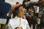 Makeup is applied to a model backstage before the start of the Tory Burch show during Fashion Week in New York, Sunday, Feb. 9, 2020. (AP Photo/Seth Wenig)
