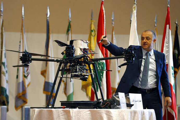 Lebanese Defense Minister Elias Bou Saab points to parts of an Israeli drone that crashed in southern Beirut last month during a press conference to announce the results of an investigation into the incident, at the Lebanese Defense Ministry, in Yarzeh near Beirut, Lebanon, Thursday, Sept. 19, 2019. The investigation has concluded that two Israeli drones that crashed in the Lebanese capital last month were on an attack mission, one of them armed with 4.5 kilograms of explosives. (AP Photo/Bilal Hussein)