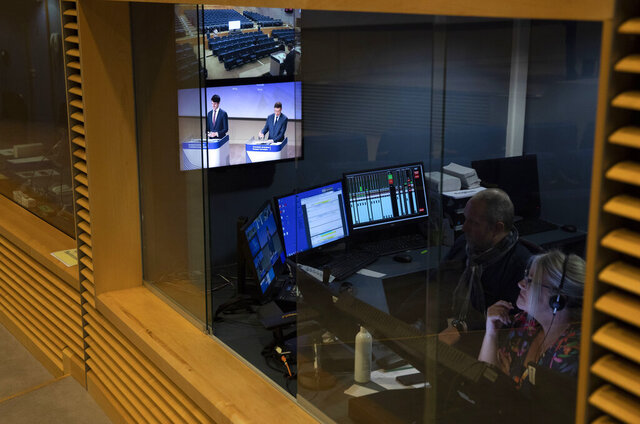 A control booth monitors the press conference of European Commissioner for An Economy that Works for People Valdis Dombrovskis regarding money laundering at EU headquarters in Brussels, Thursday, May 7, 2020. (AP Photo/Virginia Mayo, Pool)