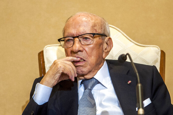 FILE - In this photo taken on Oct.3, 2018 Tunisian President Beji Caid Essebsi is pictured during a joint press conference with his Djibouti counterpart at the presidential palace in Carthage, near the Tunisian capital, Tunis. Tunisia's 92-year-old president Beji Caid Essebsi has been taken to a military hospital after falling seriously ill. (AP Photo/Hassene Dridi, File)
