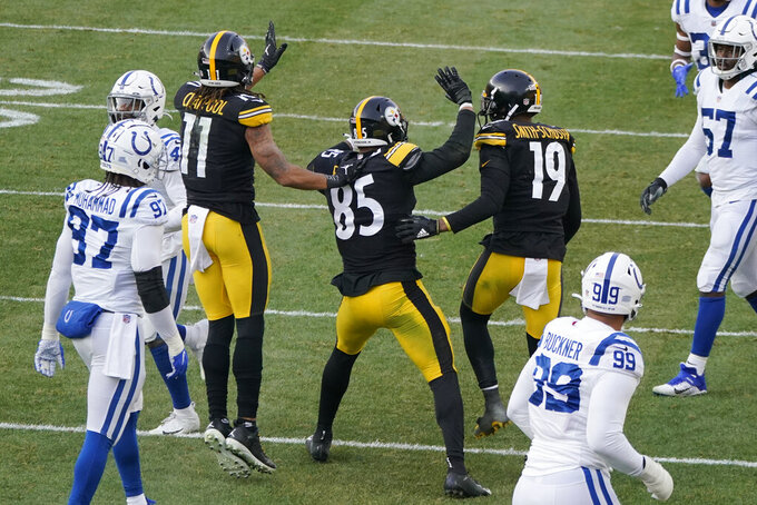 Pittsburgh Steelers tight end Eric Ebron (85) celebrates with wide receivers Chase Claypool (11) and JuJu Smith-Schuster (19) after making a touchdown catch against the Indianapolis Colts during the second half of an NFL football game, Sunday, Dec. 27, 2020, in Pittsburgh. (AP Photo/Gene J. Puskar)