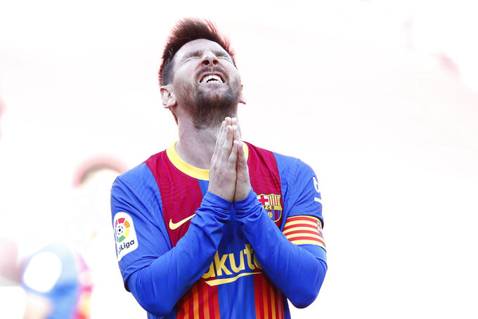 Barcelona's Lionel Messi reacts after a missed scoring opportunity during the Spanish La Liga soccer match between FC Barcelona and Atletico Madrid at the Camp Nou stadium in Barcelona, Spain, Saturday, May 8, 2021. (AP Photo/Joan Monfort)