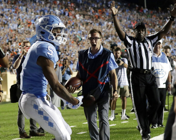 North Carolina's Dazz Newsome (5) starts to celebrate as an official signals Newsome's touchdown against Miami during the fourth quarter of an NCAA college football game in Chapel Hill, N.C., Saturday, Sept. 7, 2019. (AP Photo/Chris Seward)