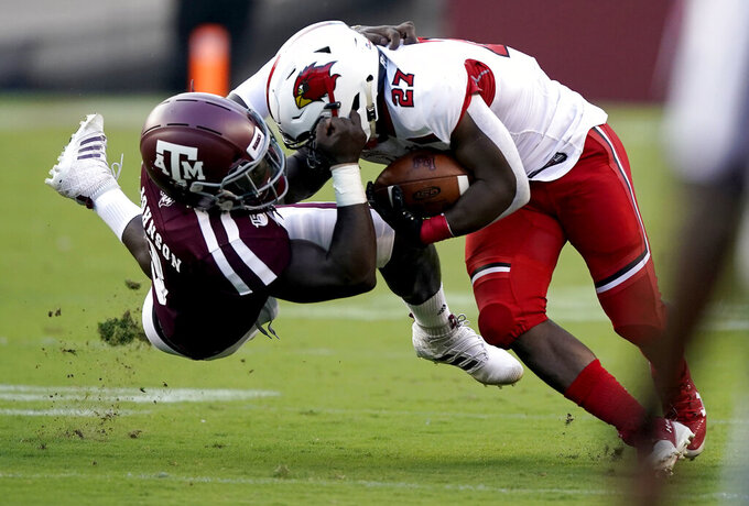 Texas A&M defensive lineman Tyree Johnson (3) grabs the facemark of Lamar running back A.J. Walker (27) while tackling him during the first half of an NCAA college football game, Saturday, Sept. 14, 2019, in College Station, Texas. (AP Photo/Sam Craft)