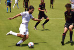 Inter Miami midfielder Rodolfo Pizarro, left, crosses the ball as Atlanta United midfielder Santiago Sosa (5) defends during the first half of an MLS soccer match, Sunday, May 9, 2021, in Fort Lauderdale, Fla. (AP Photo/Jim Rassol)