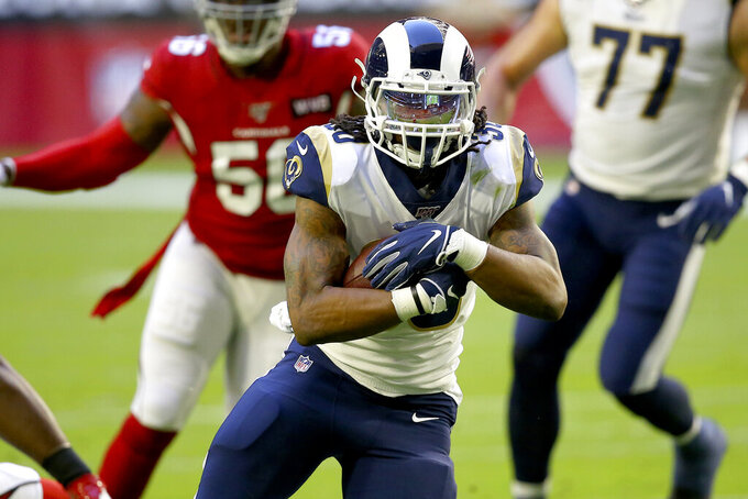 Los Angeles Rams running back Todd Gurley runs the ball against the Arizona Cardinals during the first half of an NFL football game, Sunday, Dec. 1, 2019, in Glendale, Ariz. (AP Photo/Ross D. Franklin)