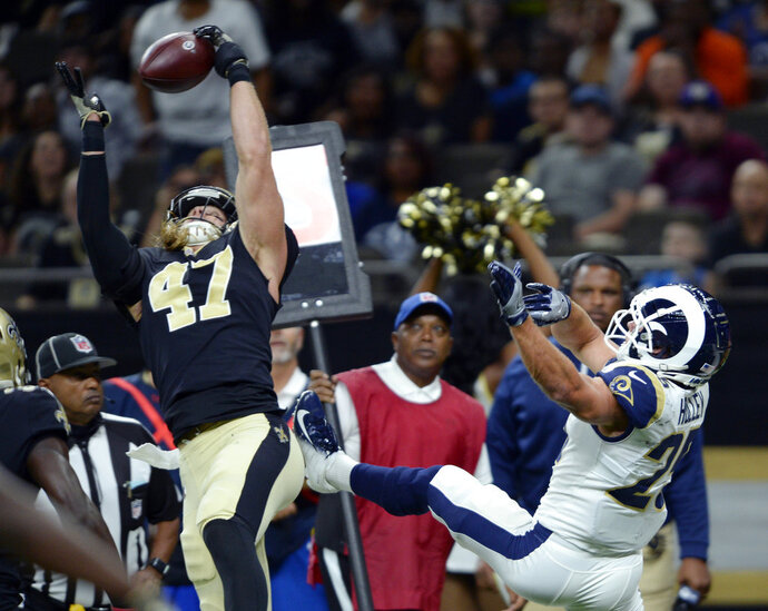 FILE - In this Aug. 30, 2018, file photo, New Orleans Saints linebacker Alex Anzalone (47) intercepts a pass intended for Los Angeles Rams running back Nick Holley (25) in the first half of an NFL preseason football game in New Orleans. No matter how much New Orleans' defense may have improved since this season's opening week, Anzalone does not see the benefit in dismissing as irrelevant the 48 points the Saints surrendered in a Week 1 loss to the Buccaneers. (AP Photo/Bill Feig, File)