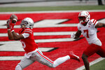 Ohio State receiver Garrett Wilson, left, catches a touchdown pass past Nebraska defensive back Dicaprio Bootle during the first half of an NCAA college football game Saturday, Oct. 24, 2020, in Columbus, Ohio. (AP Photo/Jay LaPrete)