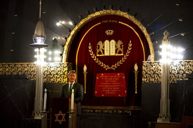 Rene de Reuver, speaking on behalf of the General Synod of the Protestant Church in the Netherlands, reads a statement at the Rav Aron Schuster Synagogue in Amsterdam, Netherlands, Sunday, Nov. 8, 2020.The Dutch Protestant Church made a far-reaching confession of guilt Sunday for its failure to do more to help Jews during and after World War II and even for the church's role in preparing