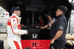 Marco Andretti, left, talks with Michael Andretti during practice for the Indianapolis 500 auto race at Indianapolis Motor Speedway, Wednesday, May 19, 2021, in Indianapolis. (AP Photo/Darron Cummings)