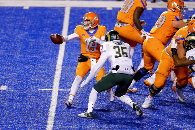 Boise State quarterback Hank Bachmeier (19) pitches the ball as Colorado State linebacker Aaron Moore (35) closes in during the first half of an NCAA college football game Thursday, Nov. 12, 2020, in Boise, Idaho. (AP Photo/Steve Conner)