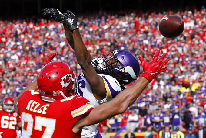 Kansas City Chiefs tight end Travis Kelce (87) can't make the catch in the end zone against the defense of Minnesota Vikings cornerback Trae Waynes (26) during the first half of an NFL football game in Kansas City, Mo., Sunday, Nov. 3, 2019. (AP Photo/Colin E. Braley)