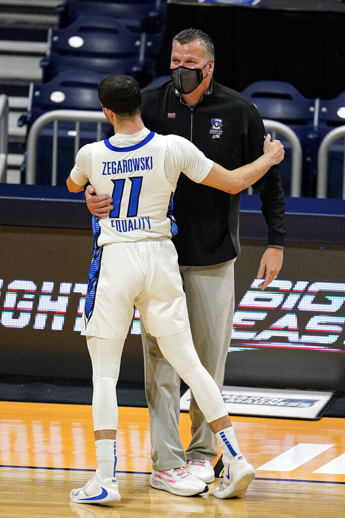 Creighton head coach Greg McDermott hugs guard Marcus Zegarowski (11) as he come out of the game in the second half of a second round game in the NCAA men's college basketball tournament at Hinkle Fieldhouse in Indianapolis, Monday, March 22, 2021. Creighton defeated Ohio 72-58. (AP Photo/Michael Conroy)