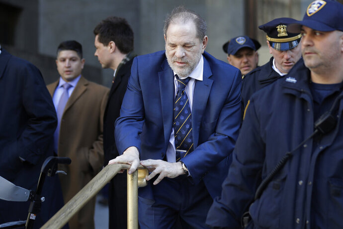 Harvey Weinstein leaves a Manhattan courthouse after closing arguments in his rape trial in New York, Friday, Feb. 14, 2020. (AP Photo/Seth Wenig)